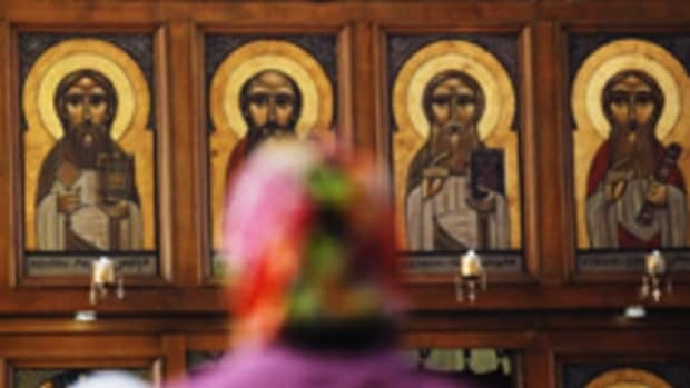 A woman stands during a Liturgy in Arabic at the Coptic Orthodox Church of Saint Mary and Saint Antonios in the Queens borough of New York on Wednesday.