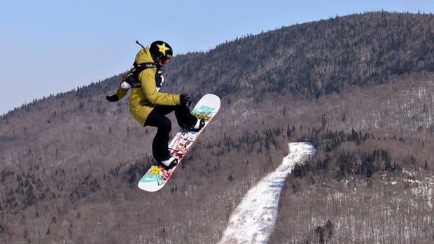 Spencer O'Brien of North Vancouver, B.C., leaps to a gold medal and a world championship title in the women's Slopestyle final on Friday at the FIS Snowboard World Championship in Stoneham, Que.