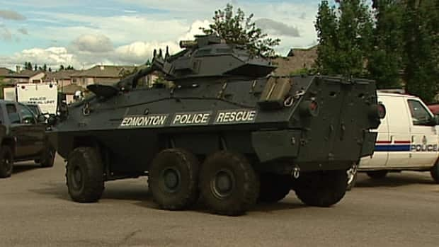 Edmonton police armoured vehicle enters Haliburton Crescent at Haddow Drive in Riverbend Monday after a man barricaded himself in a home. Police used the vehicle to enter the home.