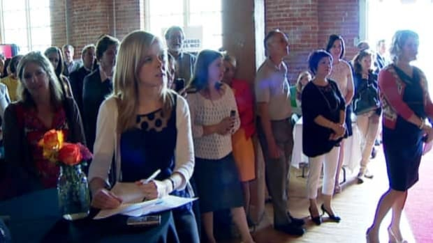 People pack in the Simmons building in the East Village as new businesses are announced for the heritage building.