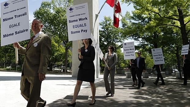 Canadian foreign service officers protest in front of the Canadian embassy in Washington, D.C., in May. The union representing them offered to enter binding arbitration last week and set a deadline for the government to accept or reject the offer by today.