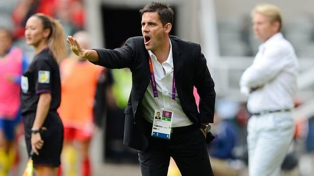 Canadian women's soccer coach John Herdman yells to his team during their women's Group F football match at the London Olympics.