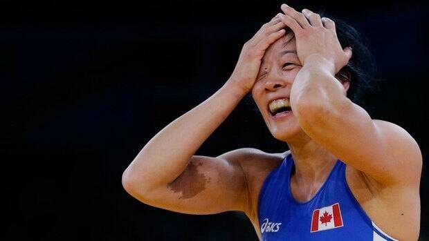 Carol Huynh celebrates her victory in her bronze-medal match against Senegal's Isabelle Sambou.