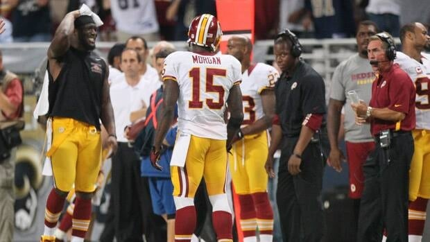 Head coach Mike Shanahan, right, is in disbelief after Redskins receiver Josh Morgan (15) picked up an unsportsmanlike conduct penalty that ultimately cost his team a victory in St. Louis on Sunday.