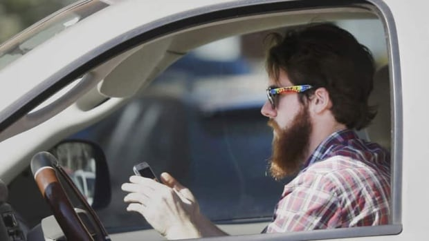 Despite fines and awareness campaigns, drivers aren't putting away their mobile devices. (Canadian Press)