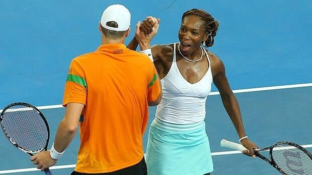 Americans Venus Williams, right, and John Isner celebrate defeating Mathilde Johansson and Jo Wilfried Tsonga of France in the mixed doubles match at the Hopman Cup Tuesday.