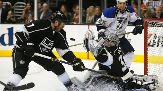 Los Angeles Kings goaltender Jonathan Quick, centre, makes a save during Game 3 against the St. Louis Blues on Saturday.