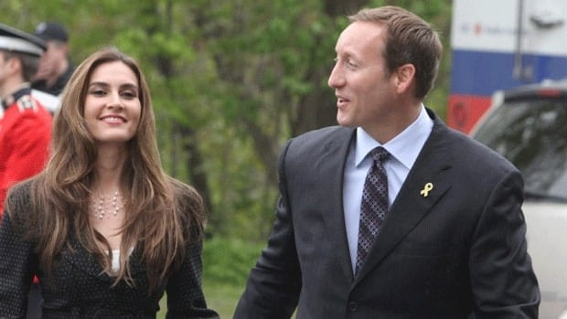 Defence Minister Peter MacKay arrives at Rideau Hall with his now wife, Nazanin Afshin-Jam, in May 2011. MacKay announced the nuptials on his constituency website Wednesday.