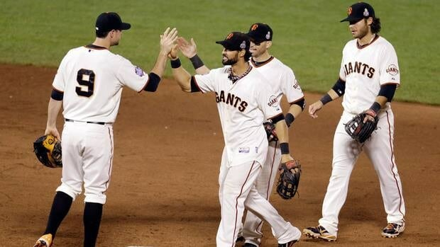 San Francisco Giants' Brandon Belt (9), Angel Pagan, Marco Scutaro and Brandon Crawford celebrate after Game 1 of the World Series against the Detroit Tigers on Wednesday.