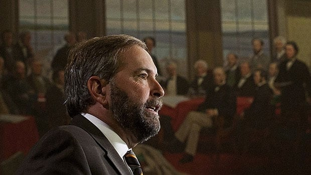 NDP leader Thomas Mulcair speaks to party caucus members on Parliament Hill in Ottawa Sept. 19. Mulcair wants Prime Minister Stephen Harper to join the premiers' meeting on the economy this fall.
