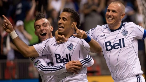 Vancouver Whitecaps FC Camilo Sanvezzo, centre, celebrates his goal with teammates Kenny Miller, right, and Russell Teibert against Chivas USA on June, 19, 2013.