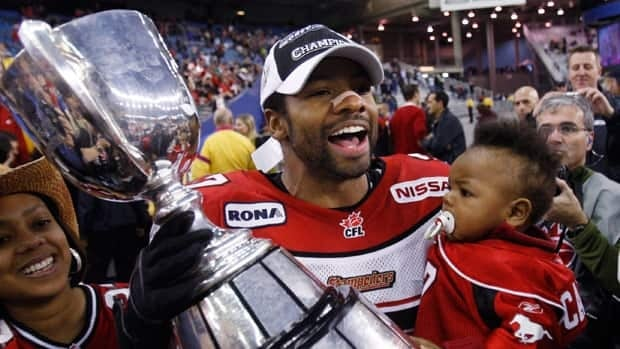 Marc Calixte holds the Grey Cup after Calgary's 2008 championship in Montreal.