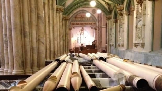 Organ pipes lying in the pews at St. Dunstan's in Charlottetown, waiting to be installed.