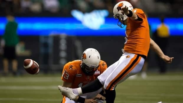 B.C. Lions kicker Paul McCallum, right, kicks a field goal as quarterback Mike Reilly holds against the Saskatchewan Roughriders in Vancouver, B.C., on Saturday November 3, 2012.
