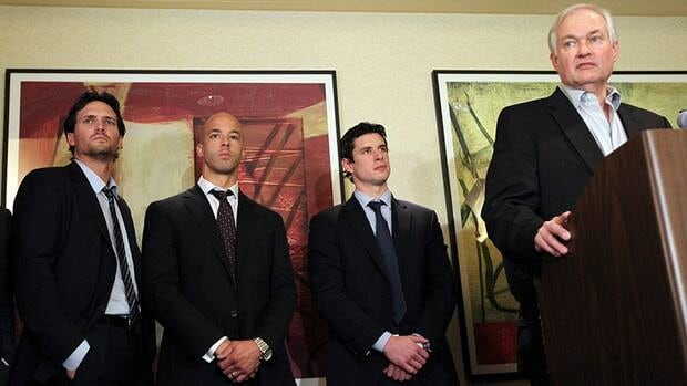 Winnipeg Jets' Ron Hainsey, left, Vancouver Canucks' Manny Malhotra, second from left, and Pittsburgh Penguins' Sidney Crosby, second from right, listens as Don Fehr, right, executive director for the NHLPA, speaks to reporters on Thursday.