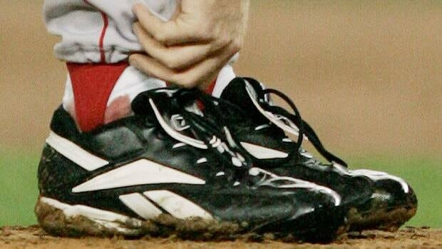 Curt Schilling helped the Red Sox snap an 86-year World Series title drought by pitching with an ankle injury that left his right sock bloodied.