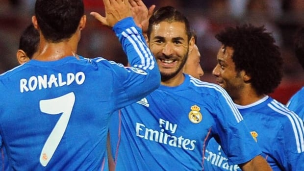 Real Madrid's Karim Benzema celebrates after scoring against Granada on August 26, 2013.