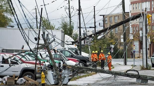 Toronto hydro workers survey the damage from superstorm Sandy on Oct. 30.