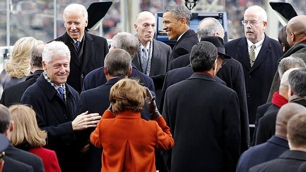 President Barack Obama and Vice President Joe Biden greet guests as they arrive at the inaugural ceremony