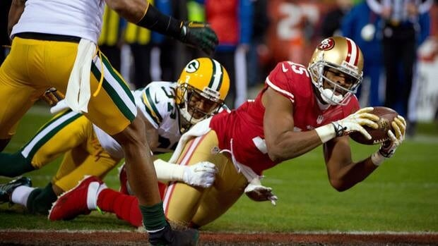 Michael Crabtree of the San Francisco 49ers scores a touchdown against the Green Bay Packers during their NFC divisional playoff game last Saturday in San Francisco.