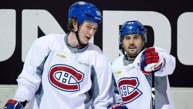 Montreal Canadiens' Ryan White, left, chats with team captain Brian Gionta during their training camp Wednesday, January 16, 2013 in Brossard, Que.