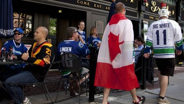 A new deal expected to end the NHL lockout is good news to many businesses, such as bars including this one in Vancouver where fans gathered prior to the start of Game 3 of the NHL Stanley Cup final in Boston on June 6, 2011.