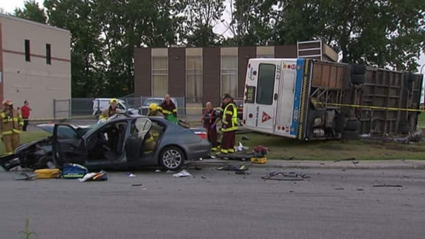 A bus collided with a BMW and tipped over Tuesday evening just south of the Montreal airport.