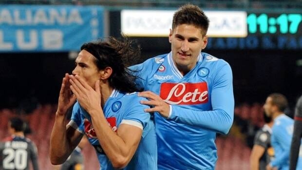 Napoli striker Edinson Cavani, left, celebrates with his teammate, defender Federico Fernandez after scoring during the match between Napoli and Bologna on Wednesday.