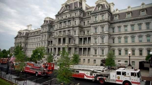 Fire trucks are seen parked between the Eisenhower Executive Office Building and the West Wing on Saturday.