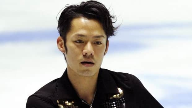 Japan's Daisuke Takahashi received a season-best 182.72 points in Friday's free skate to finish first overall and top world champion Patrick Chan.