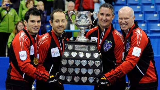 Ontario skip Glenn Howard, right to left, third Wayne Middaugh, second Brent Laing and lead Craig Savill hold the Brier Trophy following the gold medal draw against Alberta at the Brier in Saskatoon, Sask. on Sunday.