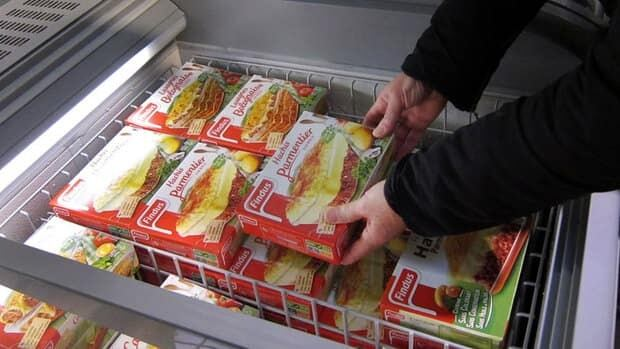 A customer takes a pack of Findus Beef Hachis Parmentier in a freezer of a supermarket in Nice, France, on Monday. Findus says horsemeat has been discovered in some of its 'beef' lasagna.