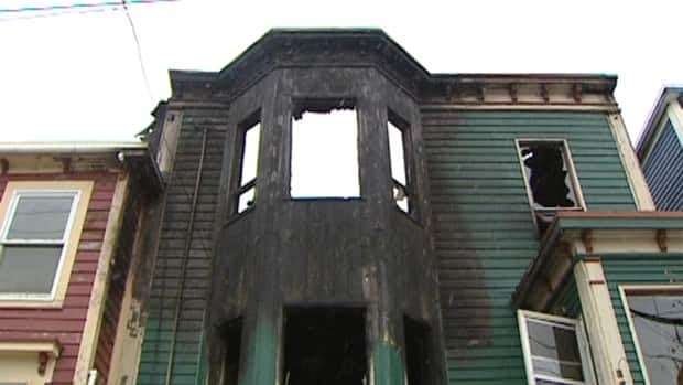 A fire at this boarding house on Springdale Street in downtown St. John's killed resident Carlos Escobar Medina, 54.