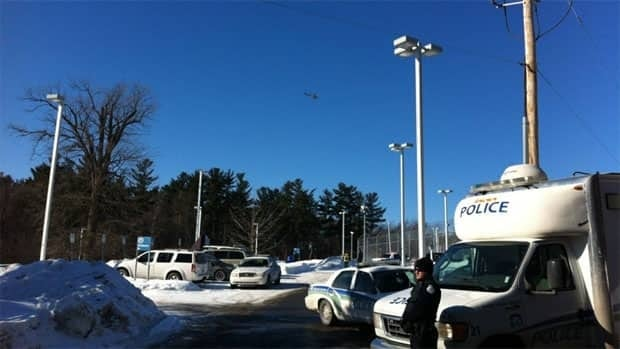 A police helicopter circles over the Hull jail where 16 inmates refused to get back in their cells.