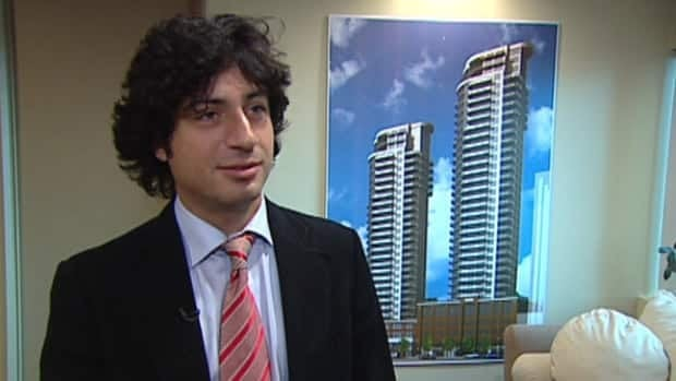 Langham Developments President Reza Mostashari stands in front of a picture of the Icon Towers.