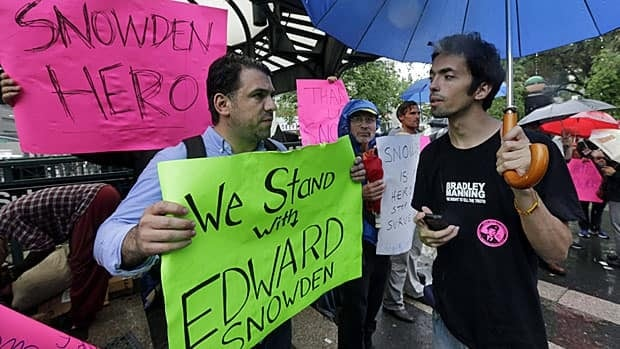 Pro-Ed Snowden demonstrators rally in New York's Union Square Park on Monday. The debate may be just beginning.
