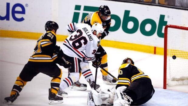 Blackhawks forward Dave Bolland (36) buries his Stanley Cup-winning goal past Boston Bruins goalie Tuukka Rask, bottom right,  Monday night.