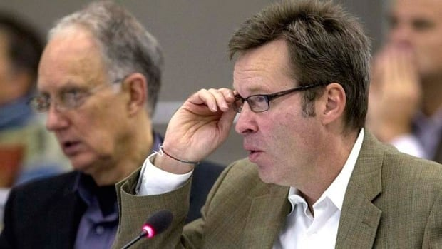 Counsel for the province of B.C. Christopher Jones, right, and Martin Gertsma question members of the Enbridge panel in Prince George, B.C., Wednesday.