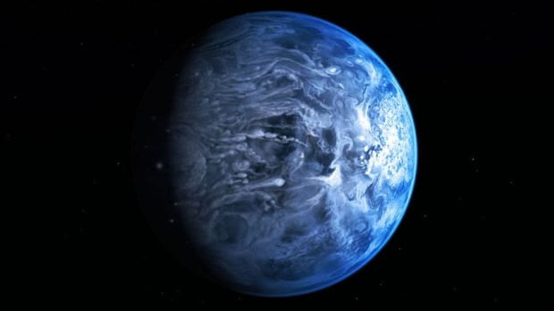 The planet, seen in an artist's conception, doesn't have any oceans. Instead, the blue colour is caused by dust, made of glass, swirling violently in the planet's atmosphere, where winds are whipping by at about 7,000 kilometres per hour.