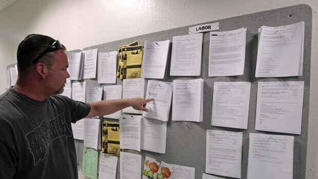 A job seeker checks a job board in California. The U.S. economy posted the smallest number of new jobs in a year last month.