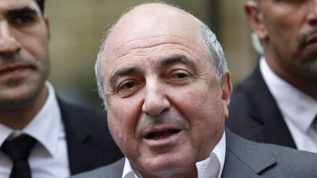 Russian tycoon Boris Berezovsky talks to the media after losing his case against Russian oligarch Roman Abramovich as he leaves the High Court in London, Friday, Aug. 31, 2012.