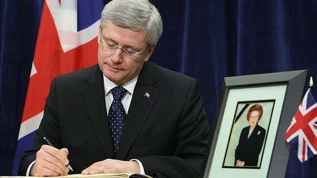 Prime Minister Stephen Harper signs a book of condolence for Margaret Thatcher at the British High Commission in Ottawa on Tuesday.