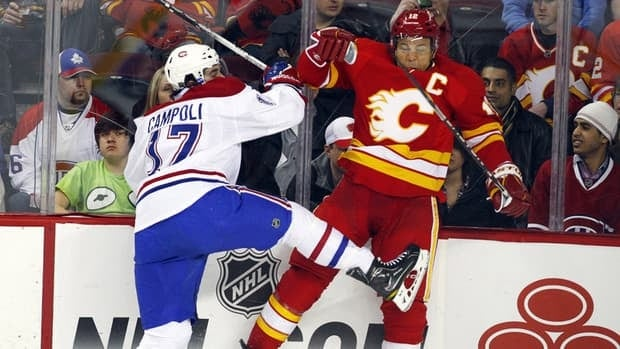 Montreal Canadiens' Chris Campoli, left, collides with Calgary Flames' Jarome Iginla during the second period on Tuesday night.