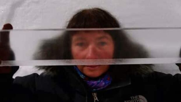 Professor and project leader Dorthe Dahl-Jensen with a section of the NEEM ice core. A vast number of measurements are needed to reveal the climate secrets of the ice.