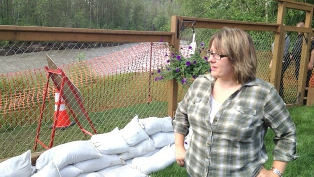 Fort McMurray resident Kelly Tuohey worries her property may soon slide into the Hangingstone River, now surging at historically high levels.