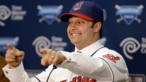 Cleveland Indians' Nick Swisher gestures as he answers questions during a news conference on Thursday in Cleveland. Swisher passed his physical with the Indians and signed the four-year, $56 million contract he agreed to last month.