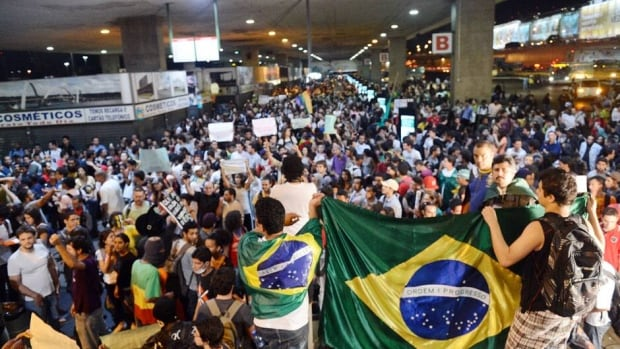 Students take over a bus station in Brasilia during a protest on Wednesday, calling for a public transport free pass in Brazil's Federal District.