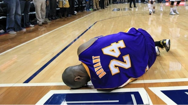 Kobe Bryant lays on the floor after being injured in the final seconds of a loss to the Atlanta Hawks.