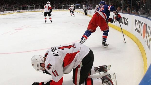 Daniel Alfredsson of Ottawa was left dazed in the second period, courtesy of a high hit from New York defenceman Carl Hagelin.
