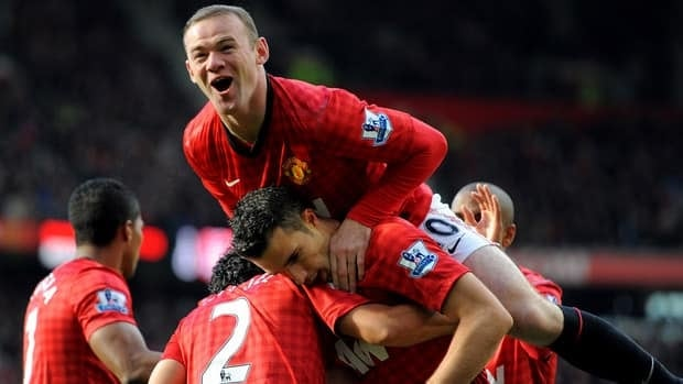 Manchester United players celebrate after Robin van Persie scored against Aresnal at Old Trafford in Manchester, northwest England.